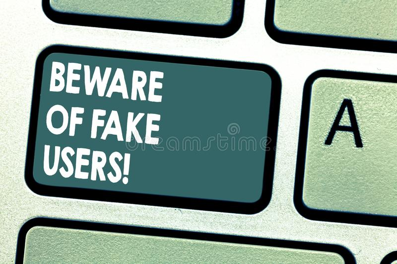 Conceptual hand writing showing Beware Of Fake Users. Business photo showcasing Be aware of safety and danger in online. Communications Keyboard key Intention stock image