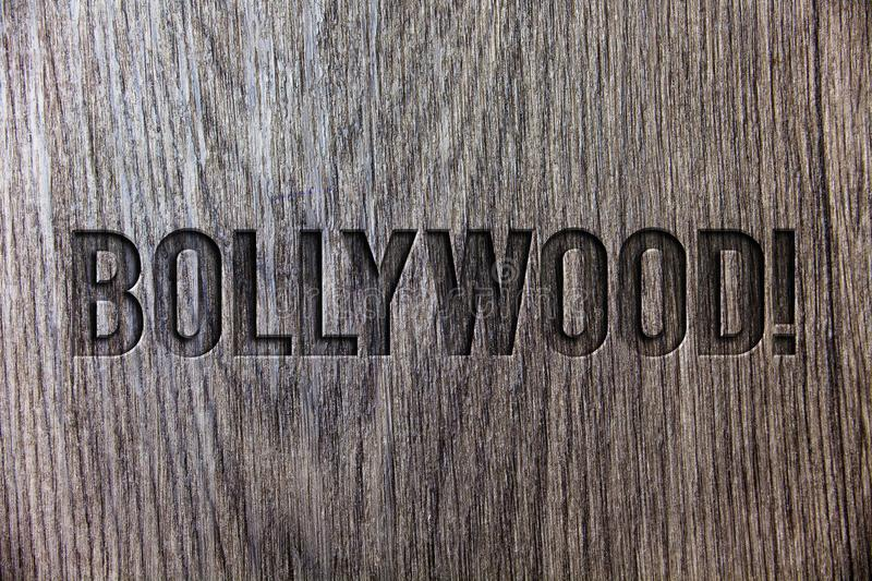 Conceptual hand writing showing Bollywood Motivational Call. Business photo showcasing Hollywood Movie Film Entertainment Cinema W. Ooden background vintage wood stock image
