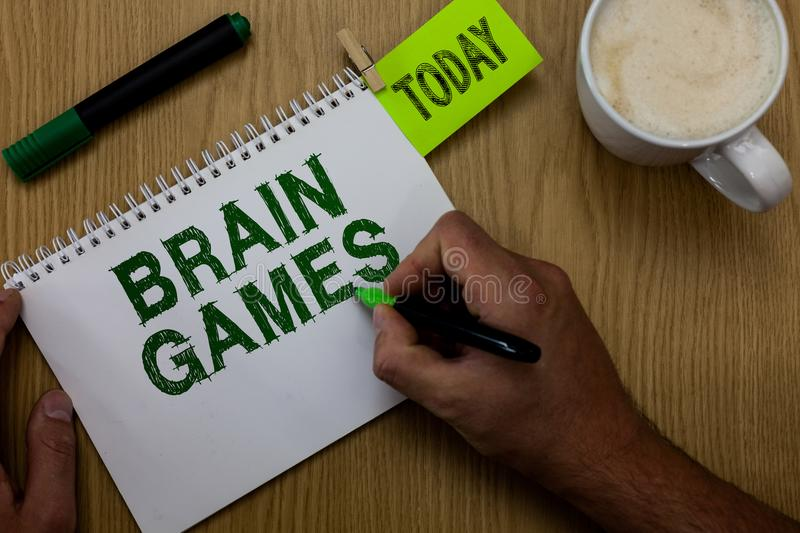 Conceptual hand writing showing Brain Games. Business photo showcasing psychological tactic to manipulate or intimidate with oppon. Ent Man holding marker royalty free stock photography
