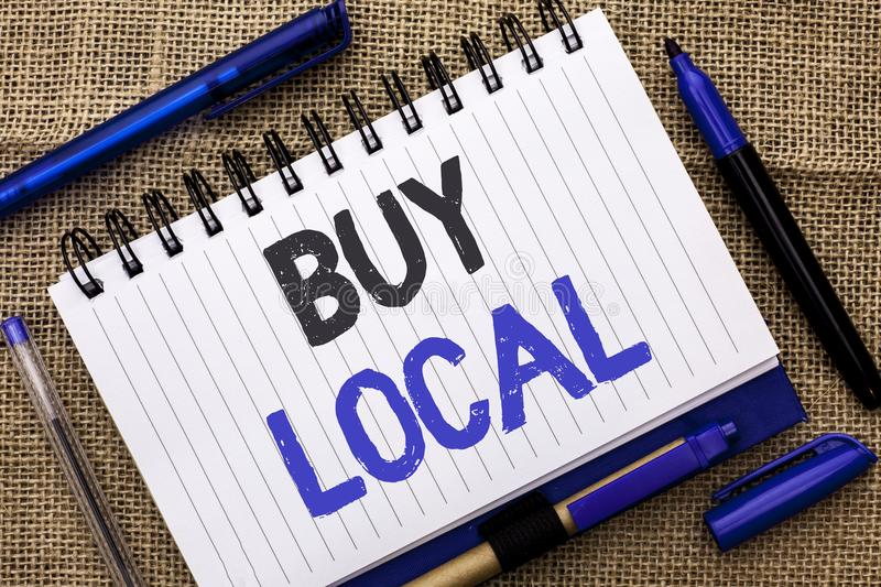 Conceptual hand writing showing Buy Local. Business photo showcasing Buying Purchase Locally Shop Store Market Buylocal Retailers. Written Notebook Book jute stock photo