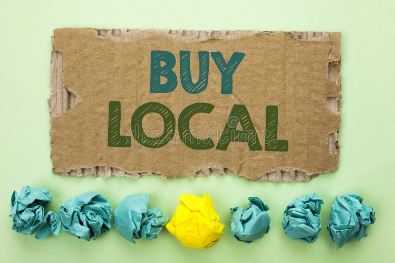 Conceptual hand writing showing Buy Local. Business photo text Buying Purchase Locally Shop Store Market Buylocal Retailers writte. N Tear Cardboard plain royalty free stock image