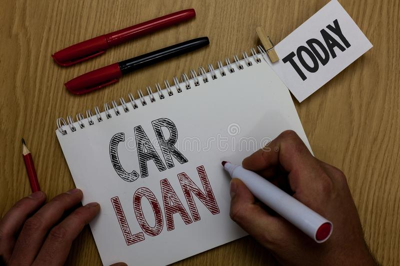 Conceptual hand writing showing Car Loan. Business photo showcasing taking money from bank with big interest to buy new vehicle Ma. N holding marker notebook stock images