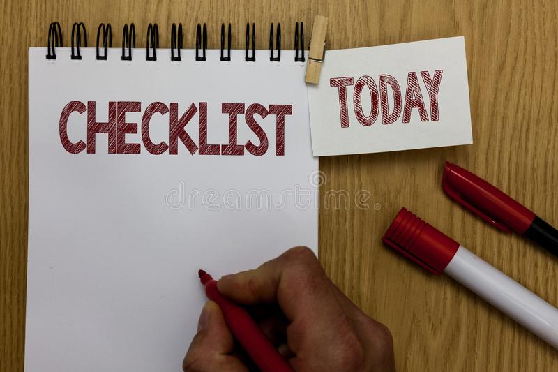 Conceptual hand writing showing Checklist. Business photo text List down of the detailed activity as guide of doing something Man. Holding marker notebook royalty free stock photography