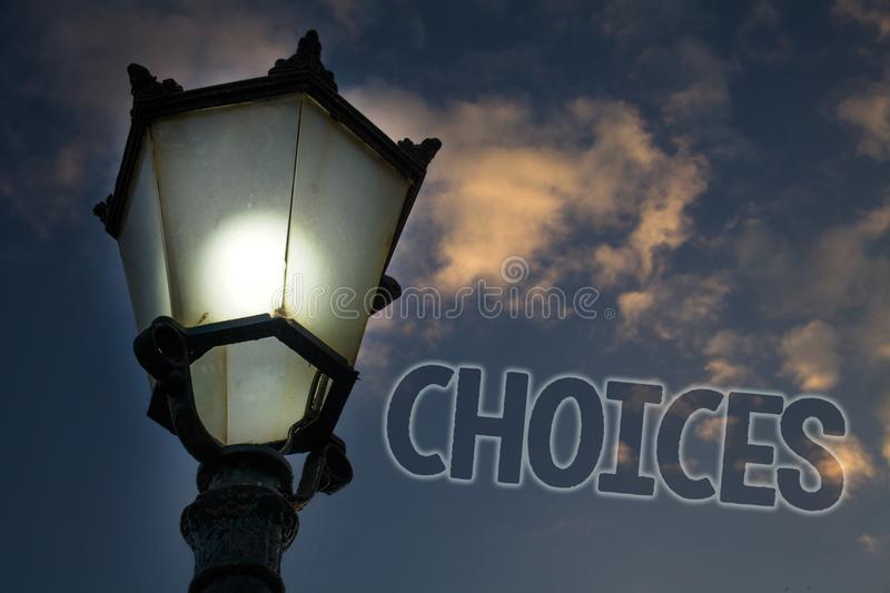 Conceptual hand writing showing Choices. Business photo showcasing Preference Discretion Inclination Distinguish Options Selection. Light post blue sky stock photography