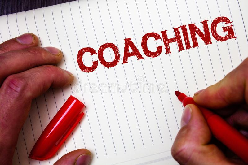 Conceptual hand writing showing Coaching. Business photo showcasing Prepare Enlightened Cultivate Sharpening Encourage Strenghten. Man hold holding marker paper royalty free stock images