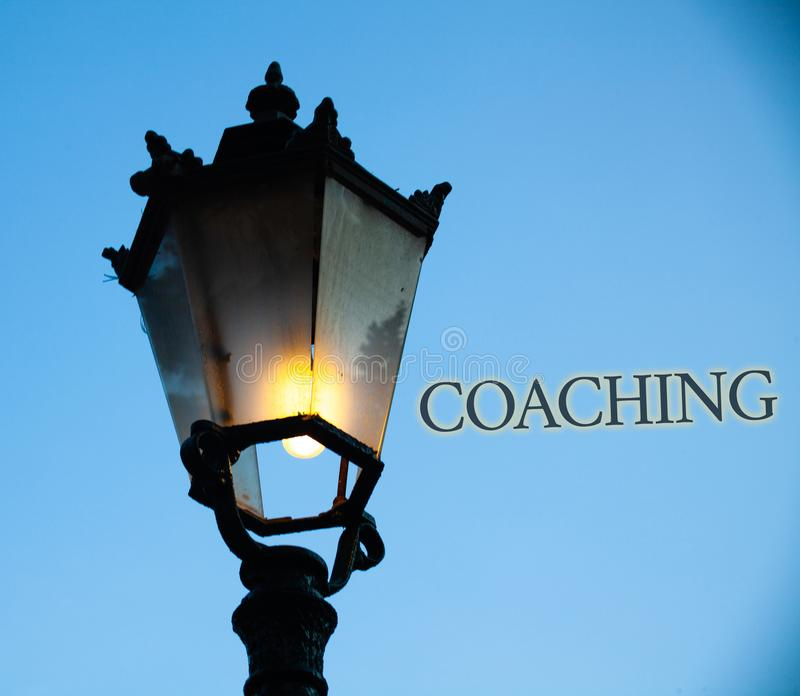 Conceptual hand writing showing Coaching. Business photo text Prepare Enlightened Cultivate Sharpening Encourage Strenghten Light. Post blue sky enlighten ideas royalty free stock image