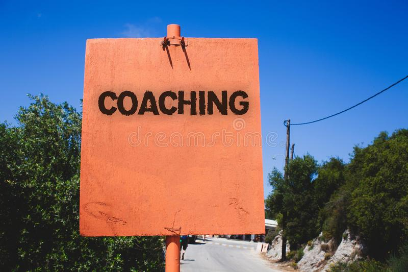 Conceptual hand writing showing Coaching. Business photo text Prepare Enlightened Cultivate Sharpening Encourage Strenghten Wooden. Board post ideas blue sky royalty free stock photography