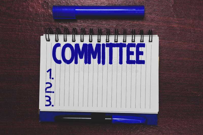 Conceptual hand writing showing Committee. Business photo text Group of showing appointed for a specific function. Company teamwork Open notebook page marker stock photo
