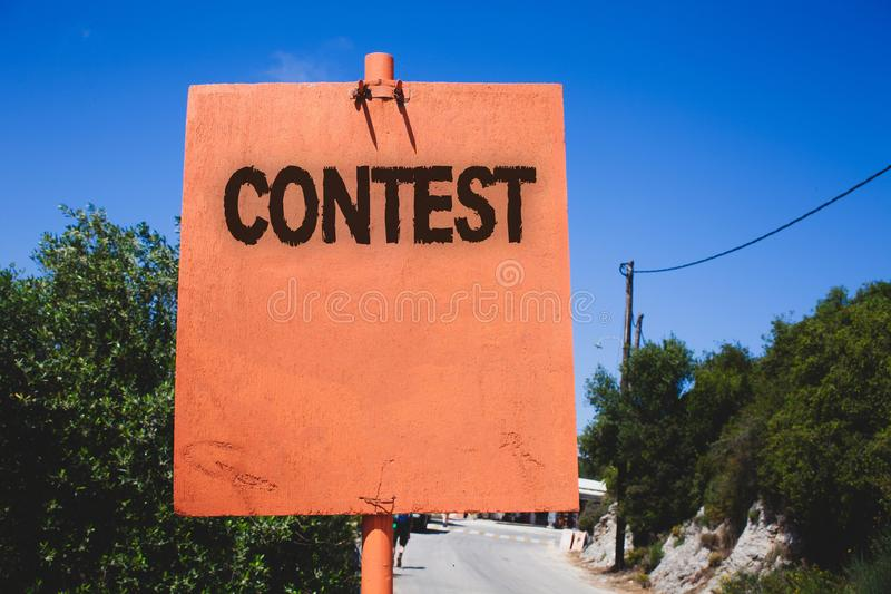 Conceptual hand writing showing Contest. Business photo text Game Tournament Competition Event Trial Conquest Battle Struggle Wood. En board post ideas blue sky stock image