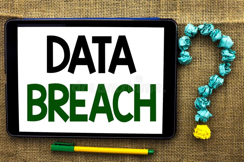 Conceptual hand writing showing Data Breach. Business photo text Stolen Cybercrime Information Hacking Security Malicious Crack wr. Itten Tablet the jute royalty free stock photography