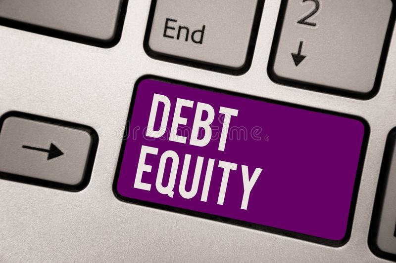 Conceptual hand writing showing Debt Equity. Business photo showcasing dividing companys total liabilities by its stockholders Key. Board purple key computer royalty free stock photos