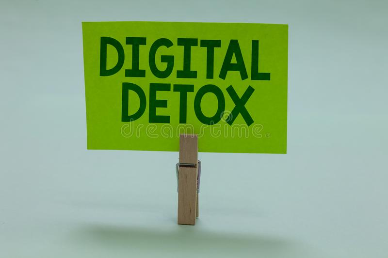 Conceptual hand writing showing Digital Detox. Business photo showcasing Free of Electronic Devices Disconnect to Reconnect Unplug. Ged Clothespin holding green royalty free stock images