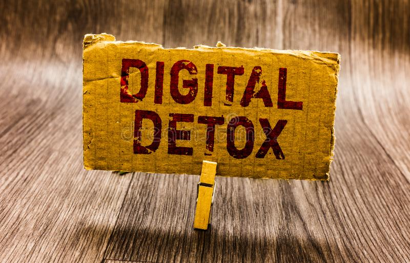 Conceptual hand writing showing Digital Detox. Business photo text Free of Electronic Devices Disconnect to Reconnect Unplugged Pa. Per notes reminders question royalty free stock images