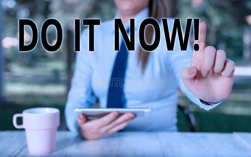 Conceptual hand writing showing Do It Now. Business photo text not hesitate and start working or doing stuff right away royalty free stock photo