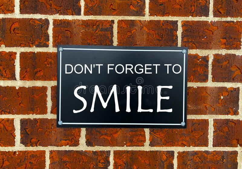 Conceptual hand writing showing Don T Forget To Smile. Business photo text Be always cheerful smiley spread and show. royalty free stock image
