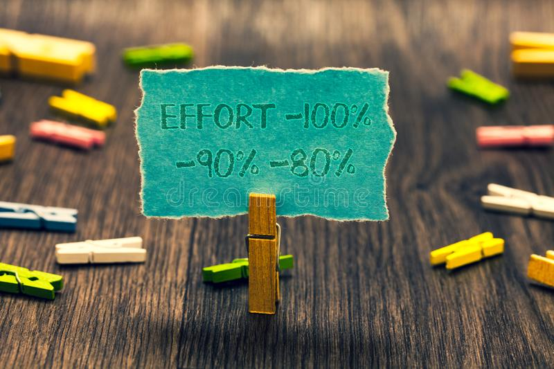 Conceptual hand writing showing Effort 100 90 80. Business photo showcasing Level of determination discipline motivation Paperclip. Retain blue cardboard blurry royalty free stock photo