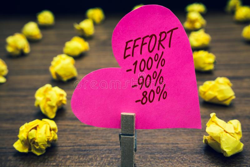 Conceptual hand writing showing Effort 100 90 80. Business photo text Level of determination discipline motivation Paperclip hold. Pink written heart woody royalty free stock photography
