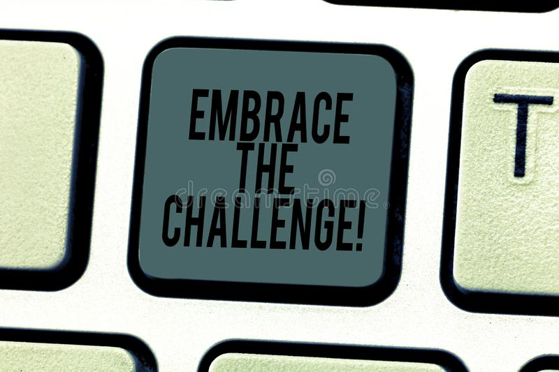 Conceptual hand writing showing Embrace The Challenge. Business photo text Face any trials that comes with dignity and. Courage Keyboard key Intention to create stock photos
