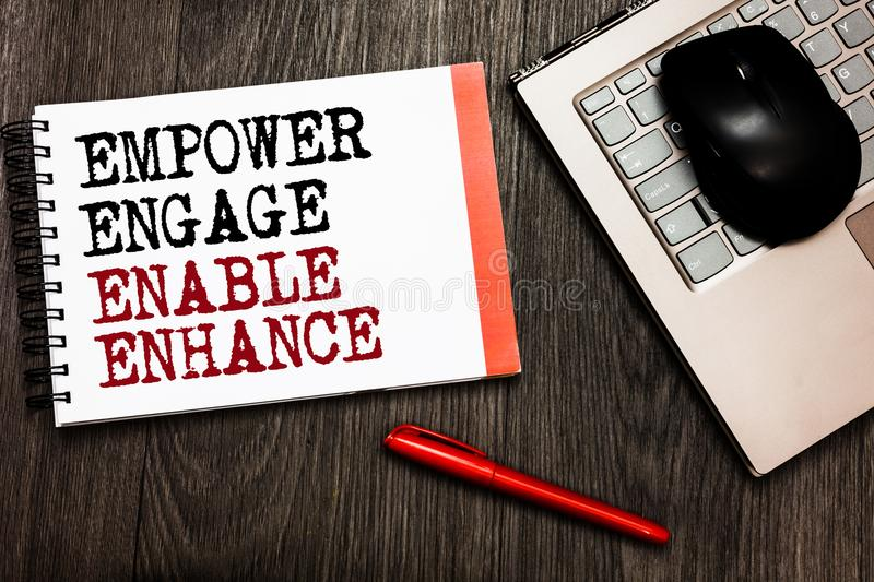 Conceptual hand writing showing Empower Engage Enable Enhance. Business photo showcasing Empowerment Leadership Motivation Engagem. Ent Bluetooth mouse on royalty free stock photo