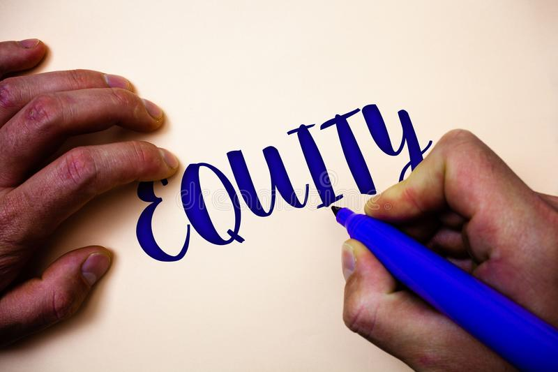 Conceptual hand writing showing Equity. Business photo showcasing Value of a company divided into equal parts owned by shareholder. S Man holding blue marker royalty free stock photo