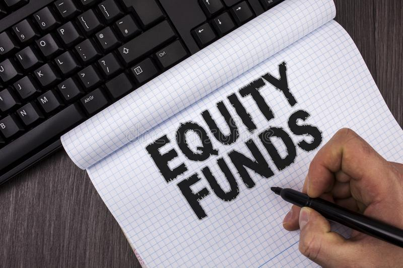 Conceptual hand writing showing Equity Funds. Business photo text Investors enjoys great benefits with long term investment writte. N by Marker in Hand Notebook stock image