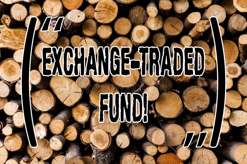 Conceptual hand writing showing Exchange Traded Fund. Business photo showcasing Marketable security that tracks a stock index. Wooden background vintage wood stock image