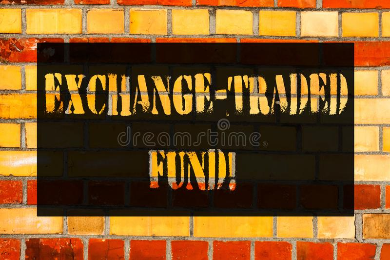 Conceptual hand writing showing Exchange Traded Fund. Business photo showcasing Marketable security that tracks a stock index. Brick Wall art like Graffiti royalty free stock photos