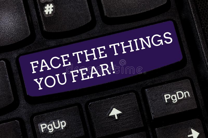 Conceptual hand writing showing Face The Things You Fear. Business photo text Have courage to confront scary situations. Keyboard key Intention to create royalty free stock photo