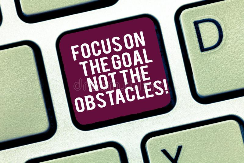Conceptual hand writing showing Focus On The Goal Not The Obstacles. Business photo text Be determined to accomplish. Objectives Keyboard Intention to create stock images