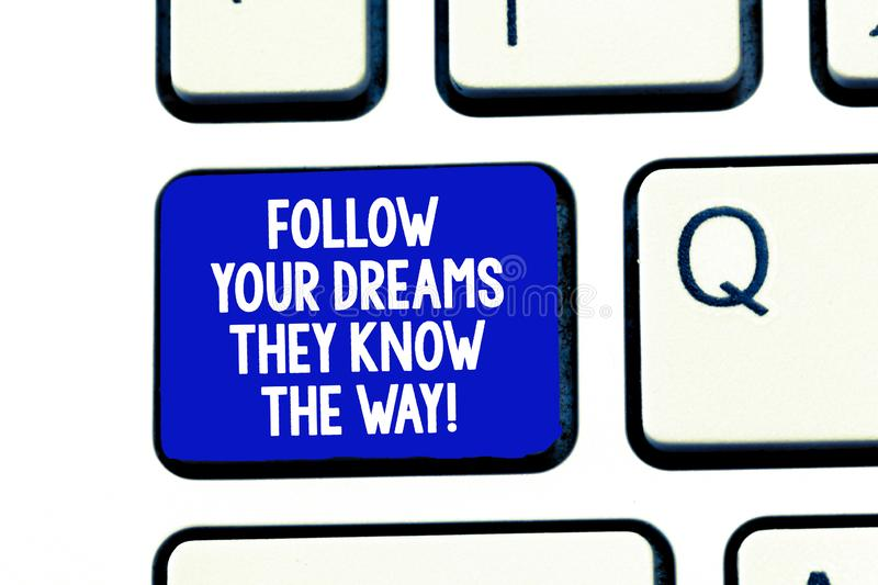 Conceptual hand writing showing Follow Your Dreams They Know The Way. Business photo showcasing Inspiration motivation. To get success Keyboard Intention to stock photo