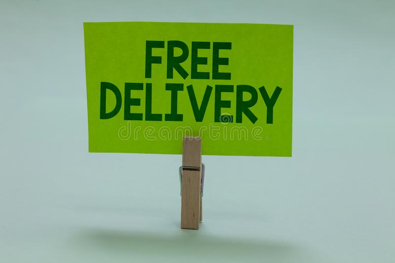 Conceptual hand writing showing Free Delivery. Business photo showcasing Shipping Package Cargo Courier Distribution Center Fragil. E Clothespin holding green royalty free stock photography