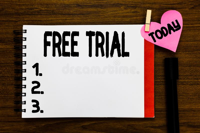 Conceptual hand writing showing Free Trial. Business photo text Product or service offered for no cost to try and give. Feedback Open notebook page markers stock images