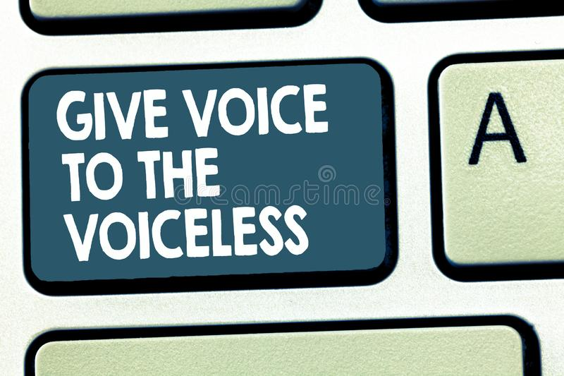 Conceptual hand writing showing Give Voice To The Voiceless. Business photo showcasing Speak out on Behalf Defend the. Vulnerable royalty free stock photo