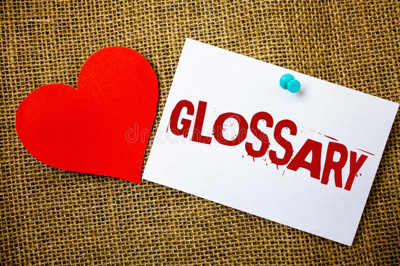 Conceptual hand writing showing Glossary. Business photo text Alphabetical list of terms with meanings Vocabulary Descriptions Mes. Sage note jute background red stock photography