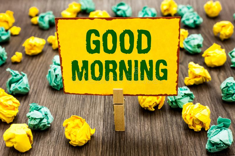 Conceptual hand writing showing Good Morning. Business photo text A conventional expression at meeting or parting in the morning C. Lothespin holding yellow note royalty free stock photo