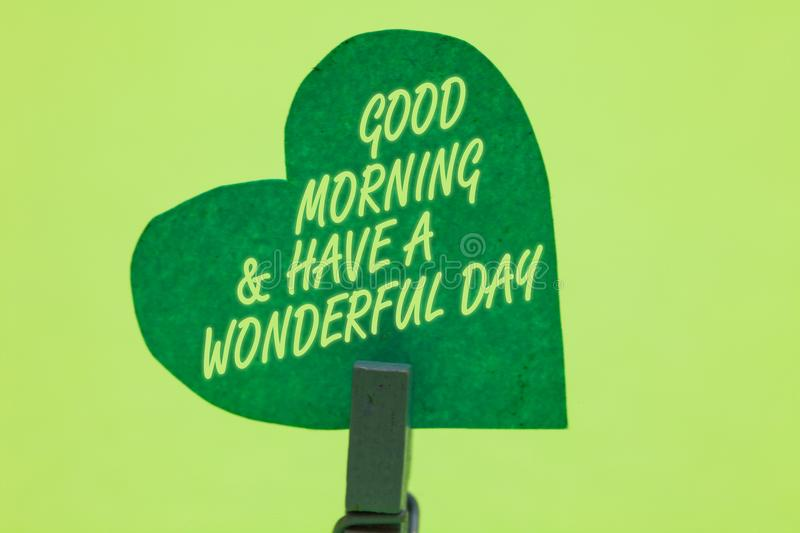 Conceptual hand writing showing Good Morningand Have A Wonderful Day. Business photo showcasing greeting someone in start of the d. Ay Clothespin holding green stock photo