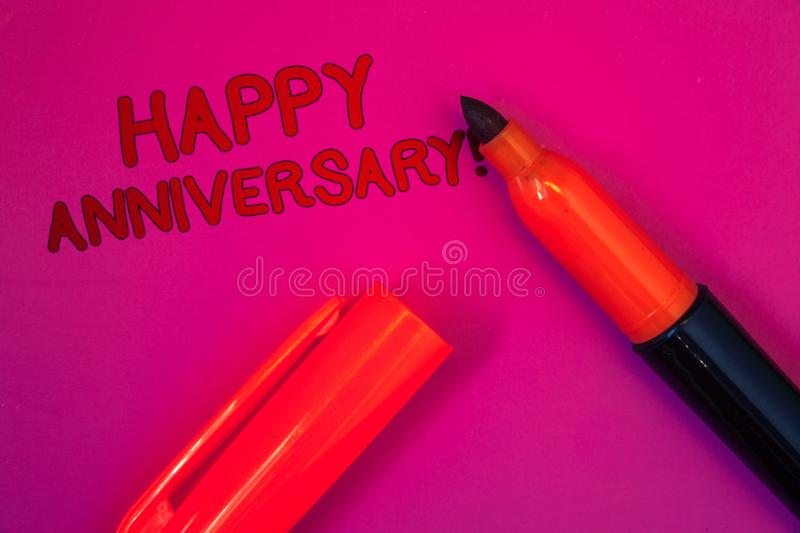 Conceptual hand writing showing Happy Anniversary Motivational Call. Business photo text Annual Special Milestone Commemoration Ma. Genta color platform dark red stock photo