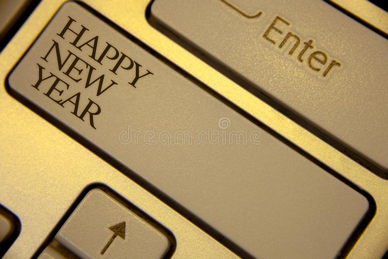 Conceptual hand writing showing Happy New Year. Business photo text congratulations Merry Xmas everyone beginning of January Keybo. Ard grey keys yellow royalty free stock images