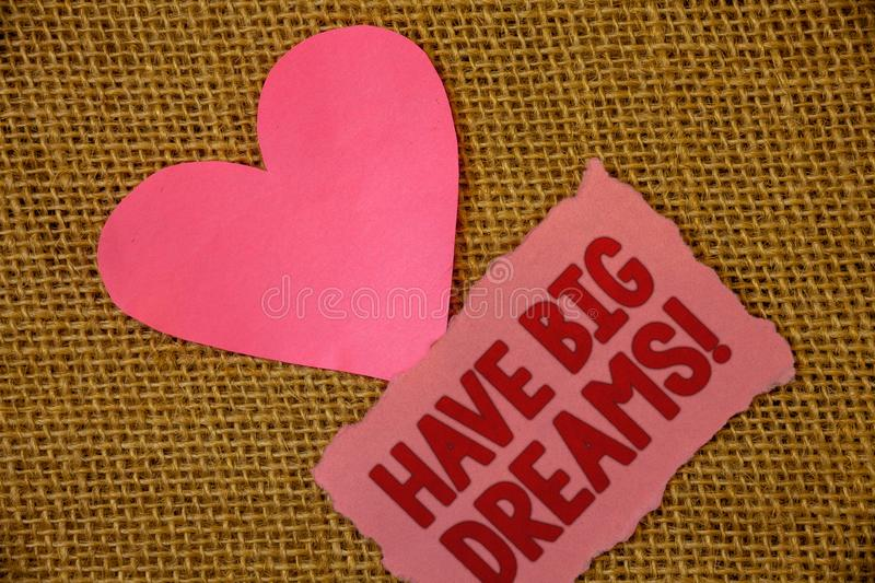 Conceptual hand writing showing Have Big Dreams Motivational Call. Business photo text Future Ambition Desire Motivation Goal Text. Pink torn paper note heart royalty free stock image