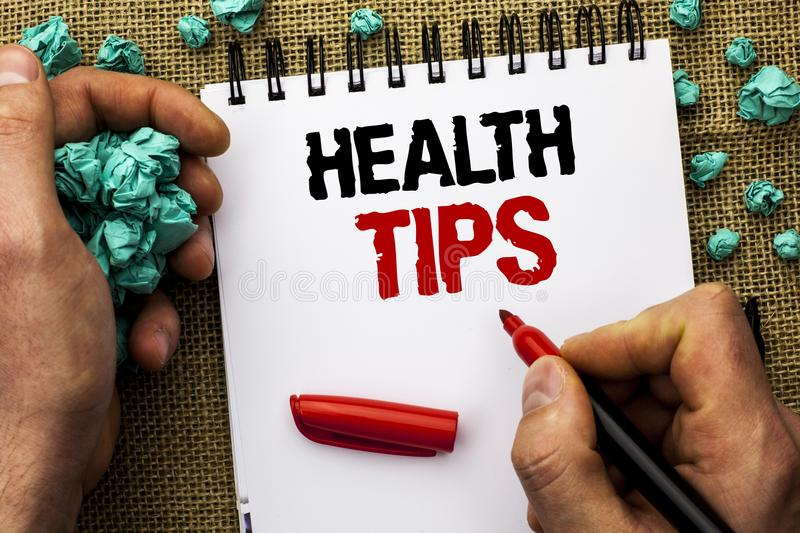 Conceptual hand writing showing Health Tips. Business photo text Healthy Suggestions Suggest Information Guidance Tip Idea written. By Man Holding Marker royalty free stock photos