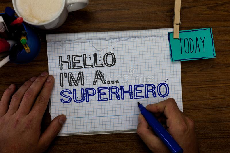 Conceptual hand writing showing Hello I am A ... Superhero. Business photo showcasing Special powers Cartoon character Customs str. Enght Hand hold pen paper stock images