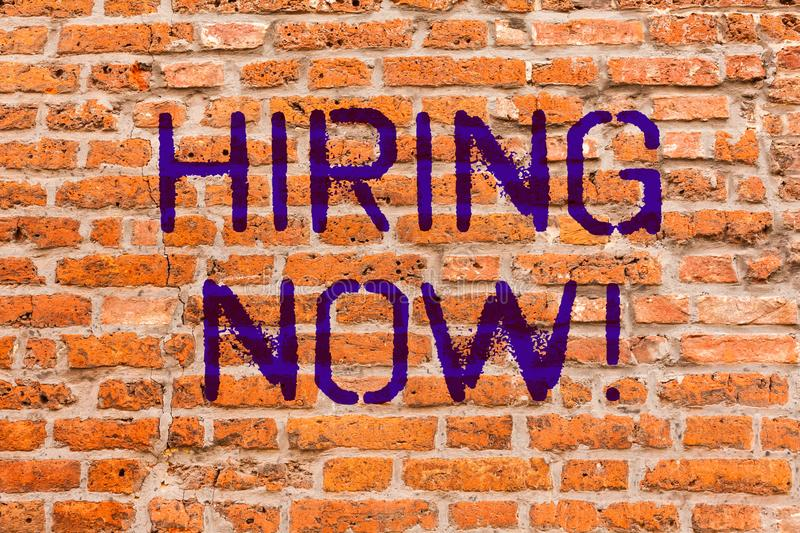 Conceptual hand writing showing Hiring Now. Business photo showcasing Workforce Wanted New Employees Recruitment Brick Wall art. Like Graffiti motivational stock images
