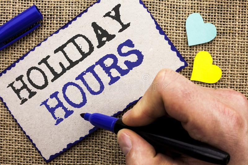 Conceptual hand writing showing Holiday Hours. Business photo showcasing Celebration Time Seasonal Midnight Sales Extra-Time Openi. Ng written Sticky Note the stock photo