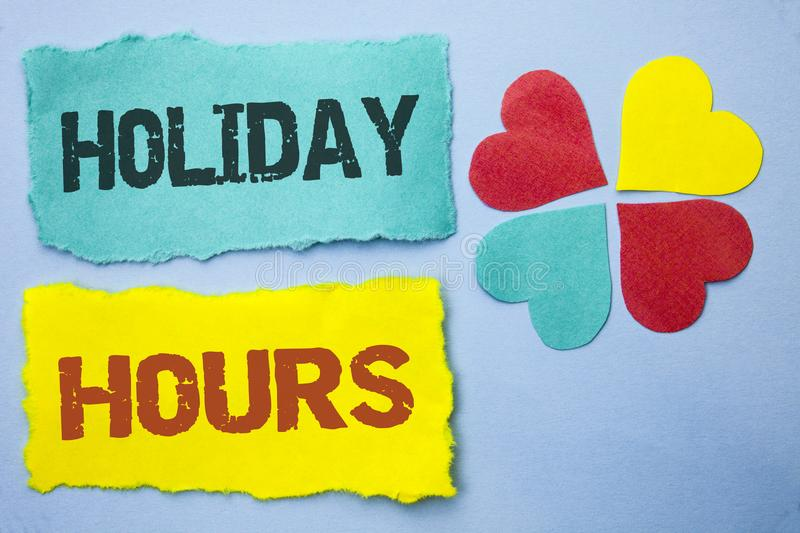 Conceptual hand writing showing Holiday Hours. Business photo showcasing Celebration Time Seasonal Midnight Sales Extra-Time Openi. Ng written Tear Papers the royalty free stock photo