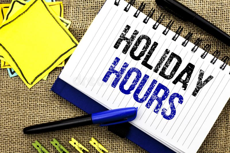 Conceptual hand writing showing Holiday Hours. Business photo showcasing Celebration Time Seasonal Midnight Sales Extra-Time Openi. Ng written Notebook Book the stock photos