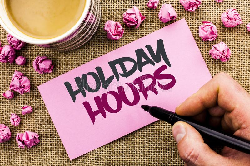 Conceptual hand writing showing Holiday Hours. Business photo text Celebration Time Seasonal Midnight Sales Extra-Time Opening wri. Tten by Man Holding Marker stock photo
