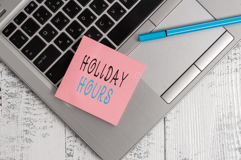 Conceptual hand writing showing Holiday Hours. Business photo text employee receives twice their normal pay for all. Conceptual hand writing showing Holiday royalty free stock photo