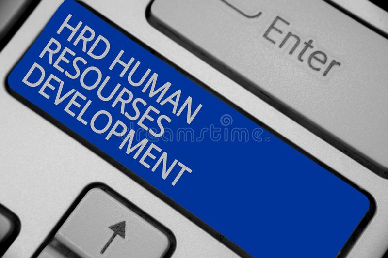 Conceptual hand writing showing Hrd Human Resources Development. Business photo text helping employees develop personal skills Key. Board blue key create royalty free stock photos