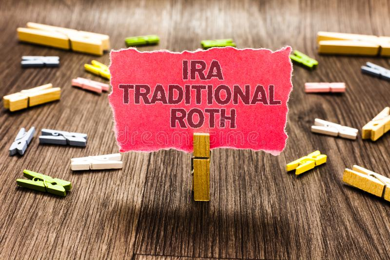 Conceptual hand writing showing Ira Traditional Roth. Business photo text are tax deductible on both state and federal Clips sprea. D woody table learn study stock photo