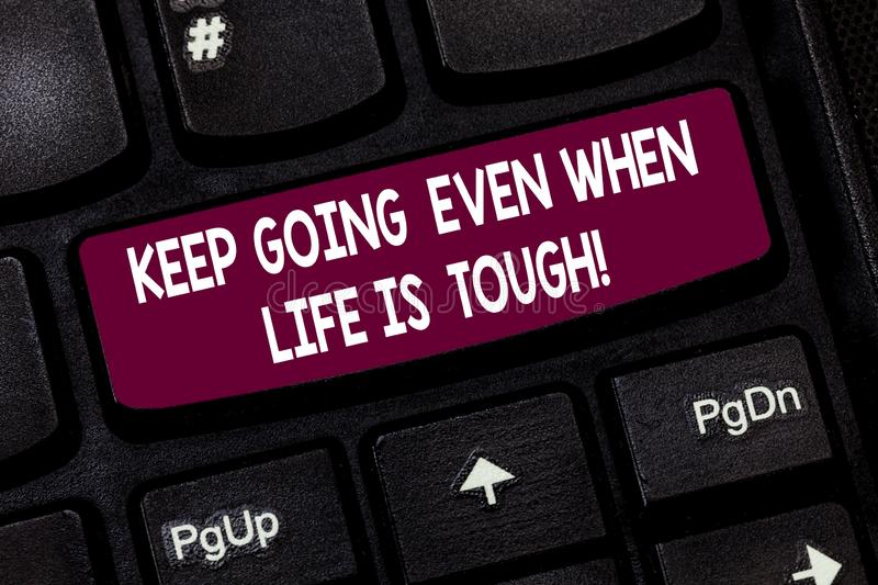 Conceptual hand writing showing Keep Going Even When Life Is Tough. Business photo text Overcome difficulties reach your. Goals Keyboard key Intention to create stock image